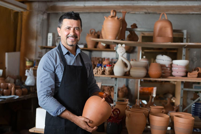 Man holding ceramic crockery
