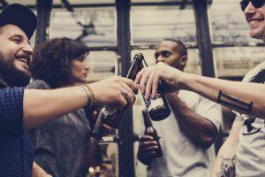 Happy people drinking craft beer