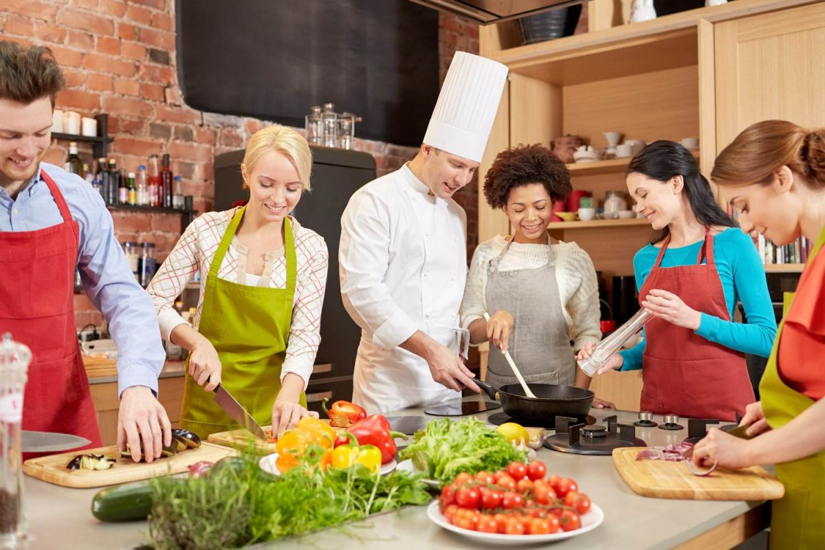 Group of adults enjoying a cooking class