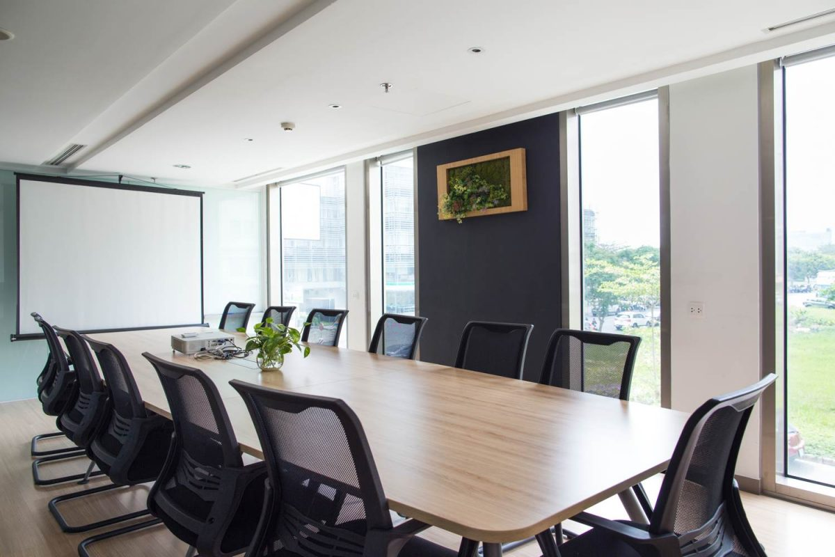 Conference room with a big table and 9 office chairs
