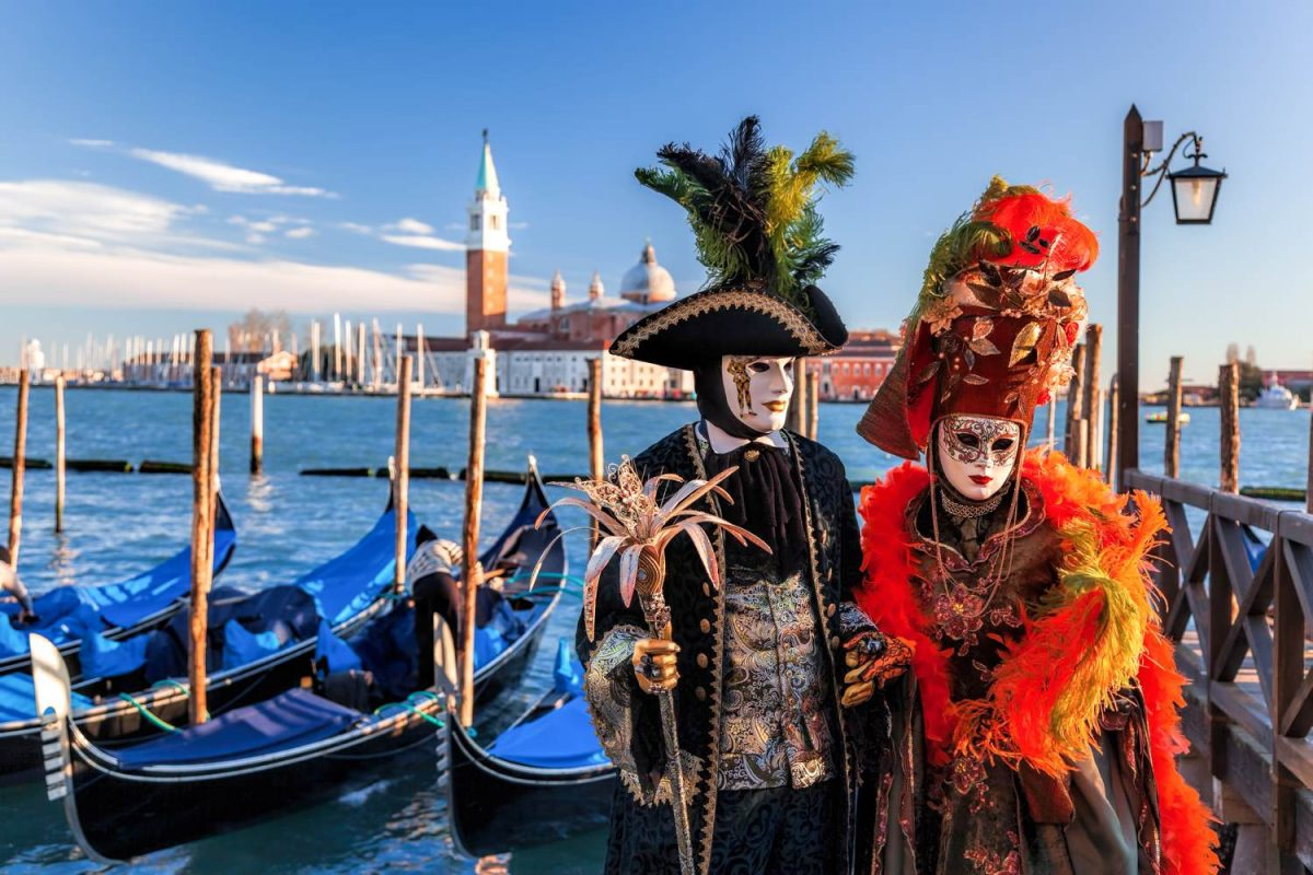 People in costume with masks at Venice Carnival