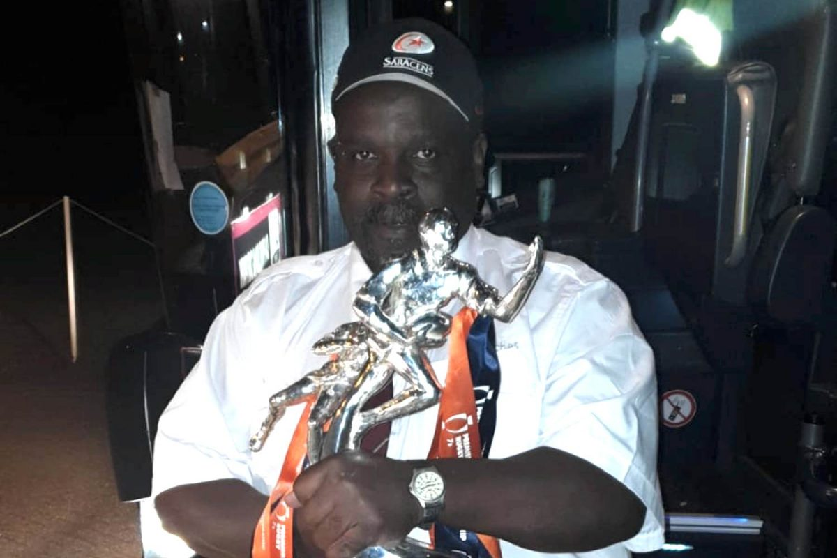 Saracens driver MET Coaches holding trophy