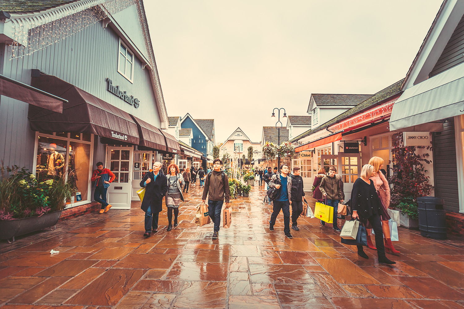 People shopping at bicester village shopping centre