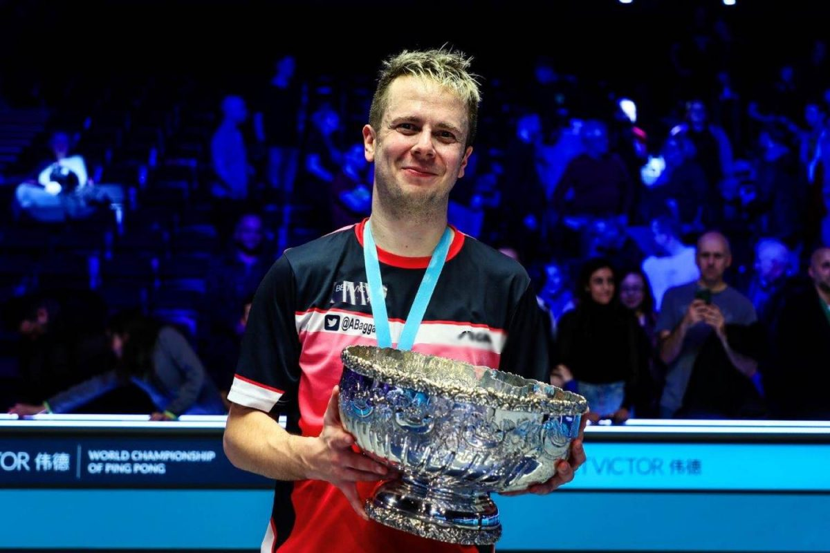 Andrew Baggaley holding trophy - Image from http://www.worldchampionshipofpingpong.net/