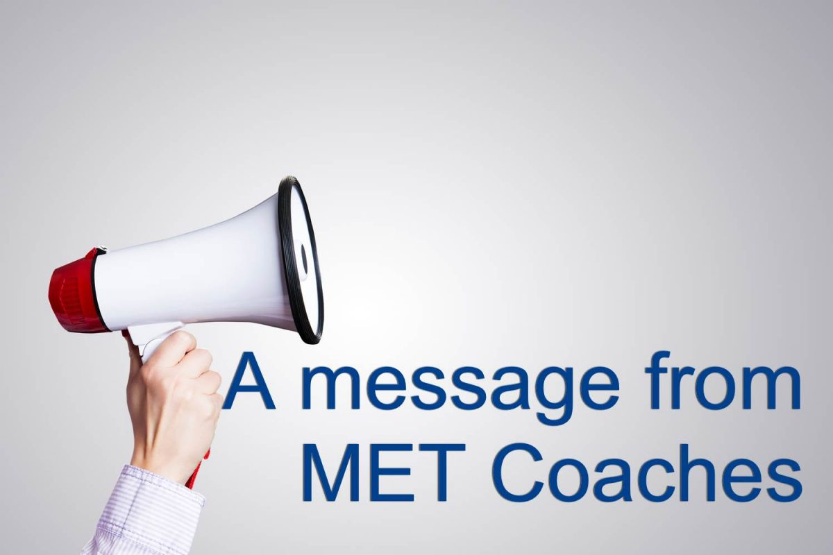 Hand holding mega phone with text saying 'a message from MET Coaches'